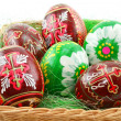 Group of painted Easter eggs in wooden basket — Stock Photo