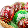Foto de Stock  : Group of painted Easter eggs in wooden basket (E