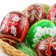 Foto Stock: Group of painted Easter eggs in wooden basket (E