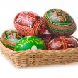 Group of easter eggs in basket isolated — Stock Photo