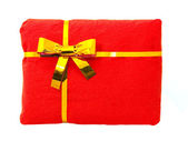Red package with a golden bow — Stock Photo