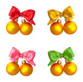 Golden balls with multicolored bows — Stock Photo