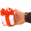 Man's hand with a gift — Stock Photo