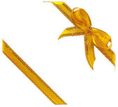 Gold ribbon with a bow on white — Stock Photo