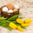 Eggs in a wicker basket — Stock Photo