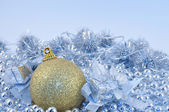 Silver blue background gold ball — Stock Photo