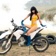 Girl with the long hair on motor cycle — Stock Photo