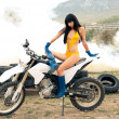 Stock Photo: Girl with the long hair on motor cycle