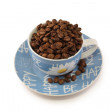 Blue white cup on a saucer — Stock Photo