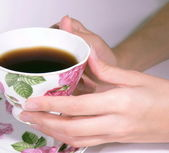 Female hands hold a coffee cup — Stock Photo