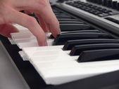 Human playing on piano — Stock Photo