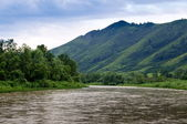 The river, mountains and overcast sky — Stock Photo