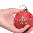 Hand holds a Christmas ornament — Stock Photo #1301286