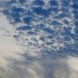 Rippled dark clouds on sky — Stock Photo