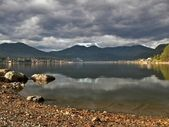Coastline lake Teletskoe and cloudscape — Stock Photo