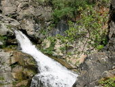 Small waterfall in mountains — Stock Photo