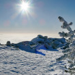 Winter mountains landscape over clouds — Stockfoto