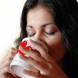 Woman drinks from a mug — Stock Photo
