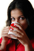 Beautiful woman drinks from a mug — Stock Photo