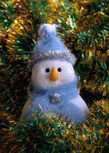 Snowball in blue hat — Stock Photo