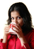 Brunette woman drinks from a mug — Stock Photo