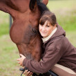 Inseparable - young girl and bay horse — Stock Photo