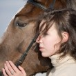 Inseparable - young girl and bay horse - Stock Photo