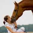 Inseparable-girl and chestnut horse — Stock Photo