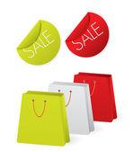 Shopping tassen en stickers — Stockvector