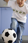 Boy kicking the ball — Stock Photo