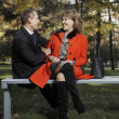 Adult couple on the bench — Stock Photo