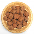 Nuts in wooden plate — Stock Photo #1353982