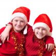 Children in red christmas hats — Stock Photo #1303527