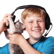 Boy and cat in head-phones — Stock Photo