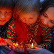 Children with candle — Stock Photo