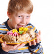 Boy with pie isolated on white — Stock Photo