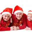 Stock Photo: Children in red christmas hats