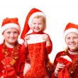 Children in red christmas hat — Stock Photo