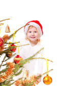Little girl with christmas tree isolated — Stock Photo