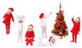 Children in christmas hat with fir — Stock Photo