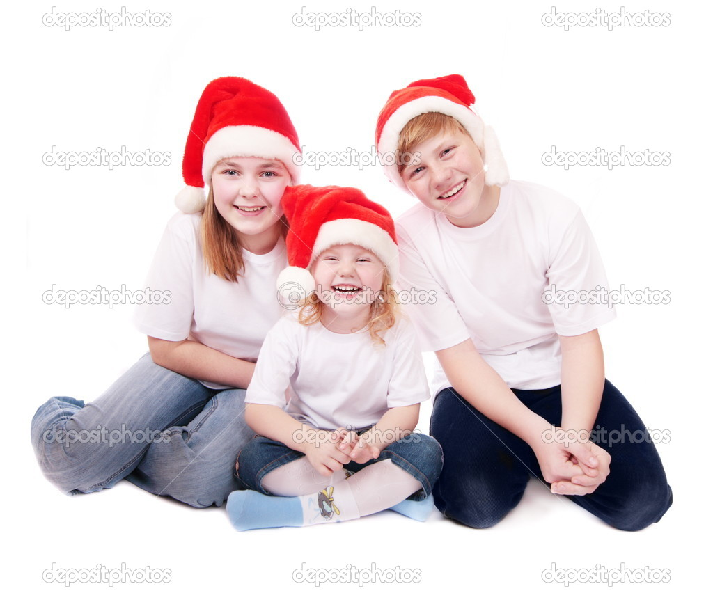 Children in red christmas hats isolated on white — Stock Photo #1303011