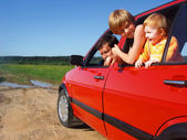 Men and children in car — Stock Photo