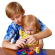 Boy and girl with plasticine — Stock Photo #1375013
