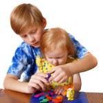 menino e menina com plasticina — Foto Stock