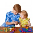 Boy and girl with plasticine — Stock Photo #1375039