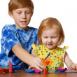 Royalty-Free Stock Photo: Boy and girl with plasticine