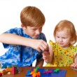 Boy and girl with plasticine — Stock Photo #1375067