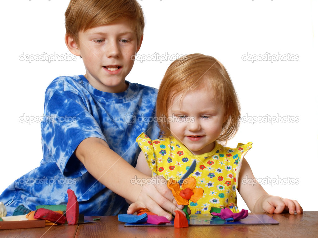 boy and girl with plasticine      — Stock Photo #1375056