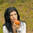 Royalty-Free Stock Photo: Girl eats ripe apple