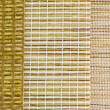 Stock Photo: Venetiblinds with rattan